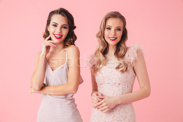 Two pretty smiling women in dresses posing together Stock photo © deandrobot