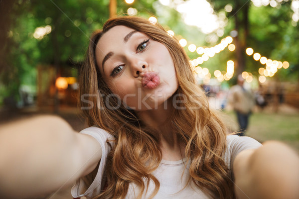 Close up of pretty young girl taking a selfie Stock photo © deandrobot