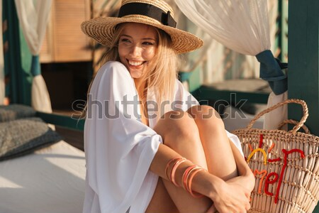 Cheerful young girl in summer hat and swimwear Stock photo © deandrobot