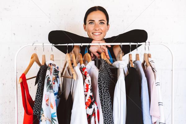 Smiling young woman clothes designer Stock photo © deandrobot