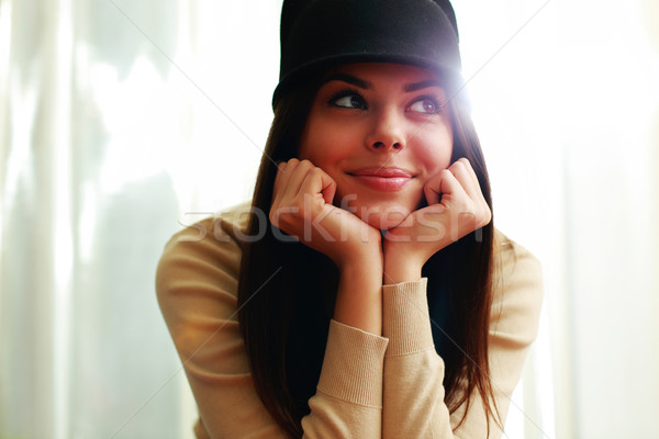 Young beautiful happy woman in hat looking away Stock photo © deandrobot