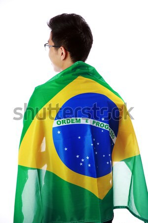 Back view portrait of a man holding Brazilian flag over white background Stock photo © deandrobot