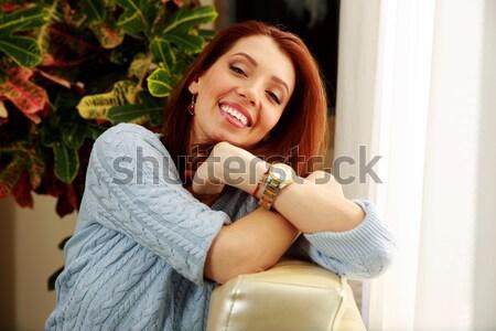Derűs nő dől kanapé otthon kék Stock fotó © deandrobot