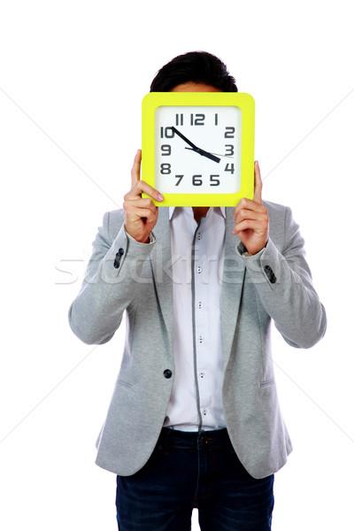 Fiatalember tart óra arc fehér iroda Stock fotó © deandrobot
