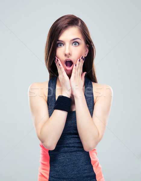 Shocked fitness woman looking at camera Stock photo © deandrobot