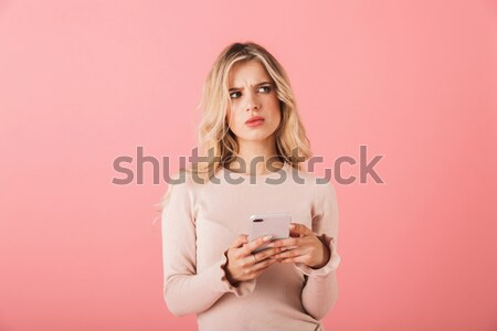 Woman holding heart shaped balloon and showing her tongue Stock photo © deandrobot