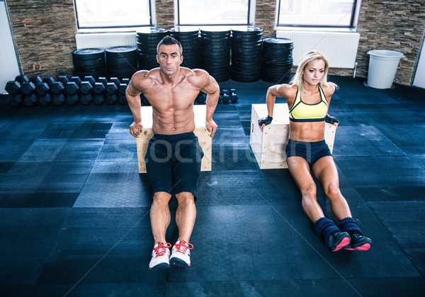 Man and woman workout with hands on fit box Stock photo © deandrobot