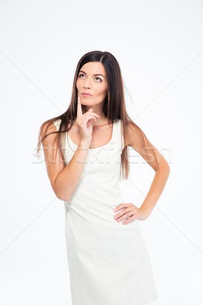 Portré töprengő nő felfelé néz izolált fehér Stock fotó © deandrobot