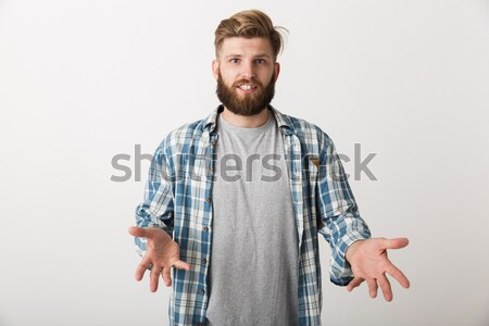 Handsome man standing with arms folded Stock photo © deandrobot