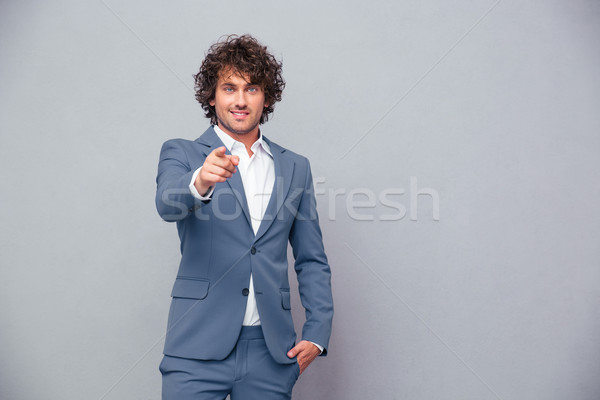 Stock fotó: Boldog · üzletember · mutat · ujj · kamera · portré