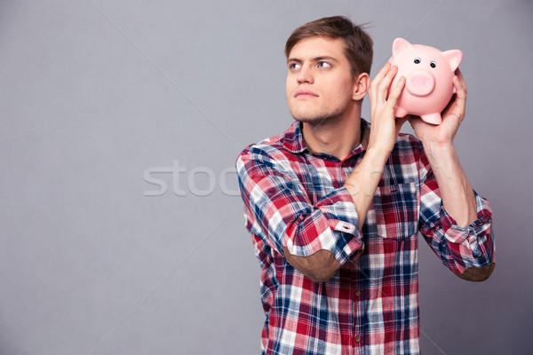Zagęszczony człowiek shirt banku piggy Zdjęcia stock © deandrobot