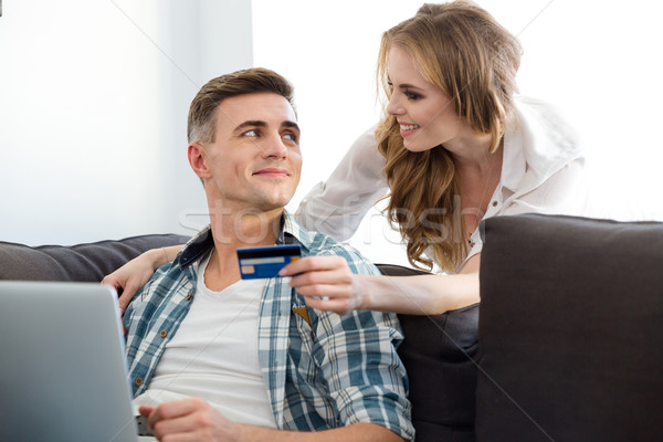 Couple making purchases in internet using laptop and  credit card  Stock photo © deandrobot