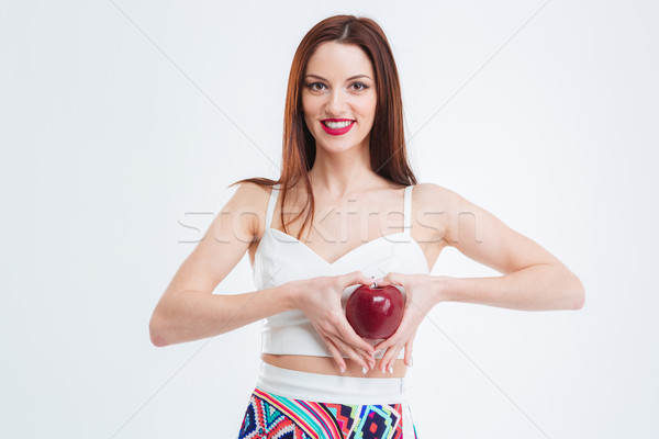 Mujer atractiva posando manzana roja feliz aislado blanco Foto stock © deandrobot