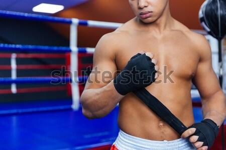 Boxer doing push ups Stock photo © deandrobot