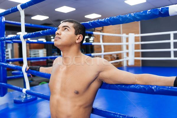 Pensativo masculino boxeador em pé ginásio Foto stock © deandrobot