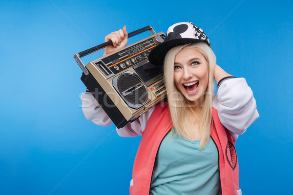 Woman holding retro boom box  Stock photo © deandrobot