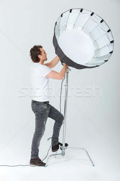 человека осветительное оборудование портрет изолированный белый Сток-фото © deandrobot