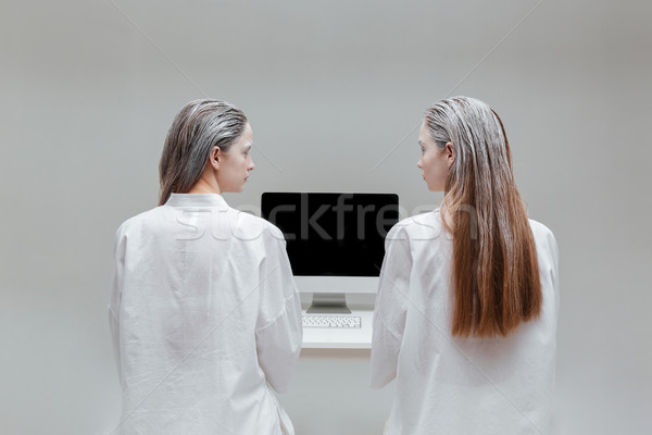 Two fashion women looking at each other  Stock photo © deandrobot