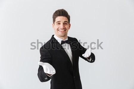 Heiter Mann Smoking stehen Aufnahme aus Stock foto © deandrobot