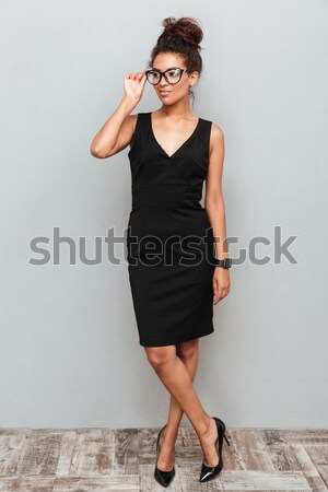 Angry irritated young businesswoman standing and throwing high heels shoes Stock photo © deandrobot