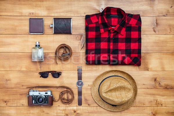 Travel concept shirt, camera, hat, flask, watch, eyeglasses, bel Stock photo © deandrobot
