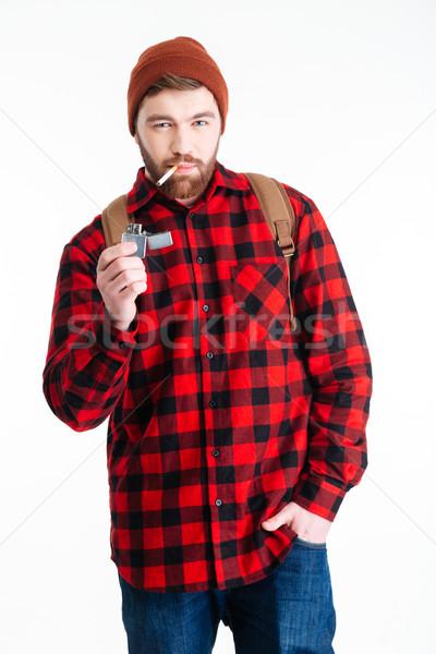 Homme éclairage cigarette isolé blanche Photo stock © deandrobot