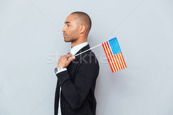 Profile of african american young man with US flag Stock photo © deandrobot
