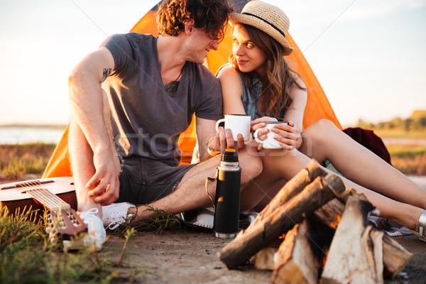 Kép pár iszik tea máglya fiatal pér Stock fotó © deandrobot