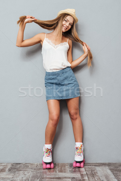 красивой улыбаясь девушки Hat коньки Сток-фото © deandrobot
