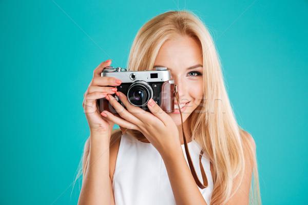 Mosolyog szőke nő elvesz fotó retro kamera Stock fotó © deandrobot
