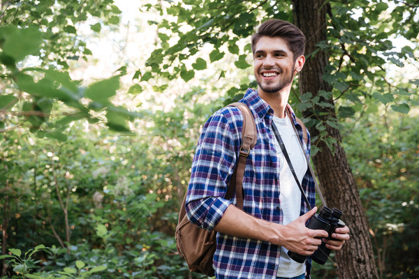 Portrait of smiling male hiker in forest Stock photo © deandrobot