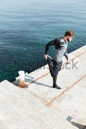 Male doing push ups near the sea Stock photo © deandrobot