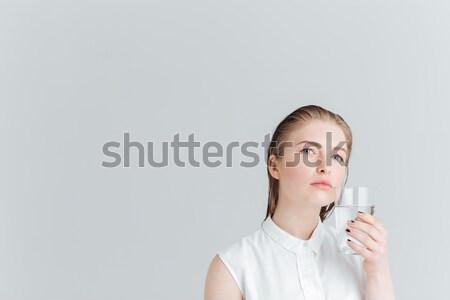Közelkép portré férfi tart óvszer száj Stock fotó © deandrobot