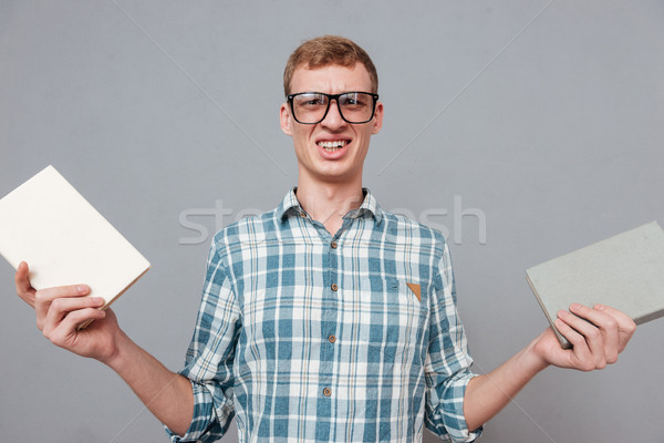 Student in glasses with books Stock photo © deandrobot