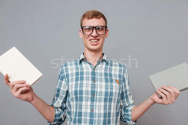 Student okulary książek studio patrząc kamery Zdjęcia stock © deandrobot
