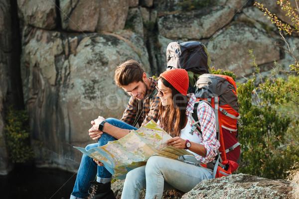 Genç macera çift harita oturma Stok fotoğraf © deandrobot
