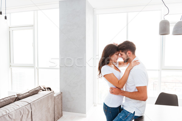 Sensual young couple standing and hugging Stock photo © deandrobot