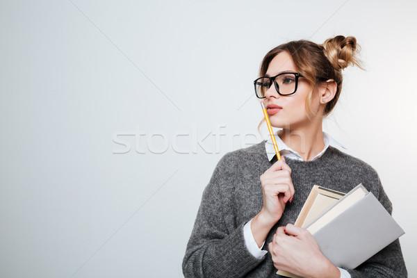 Concentrado mujer suéter libros lápiz Foto stock © deandrobot