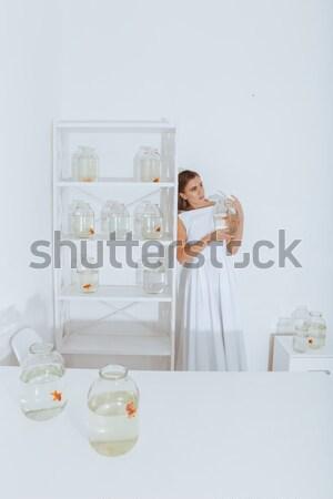 исчерпанный женщину таблице золото Сток-фото © deandrobot