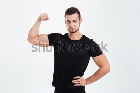 Fitness homem bíceps olhando câmera Foto stock © deandrobot