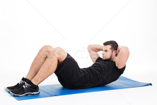Fitness man shakes press Stock photo © deandrobot