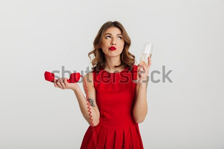 Portrait of a young woman pointing finger on alarm clock Stock photo © deandrobot