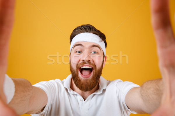 Screaming happy sportsman making selfie Stock photo © deandrobot