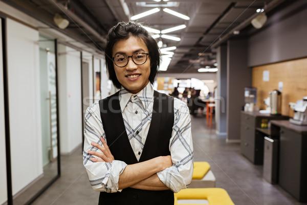 Uśmiechnięty młodych asian człowiek okulary Zdjęcia stock © deandrobot