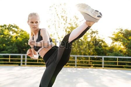 Fitness lady make yoga exercises Stock photo © deandrobot