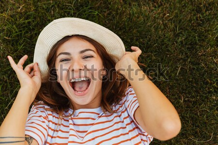 Laughing Woman in beachwear near the shrub Stock photo © deandrobot