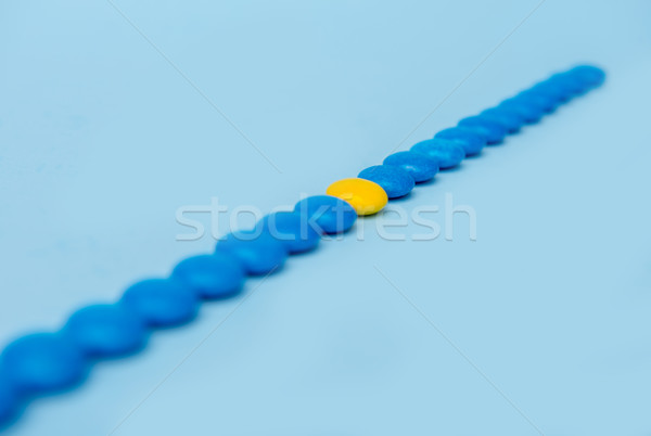Colorful sweeties candy over blue table background. Stock photo © deandrobot