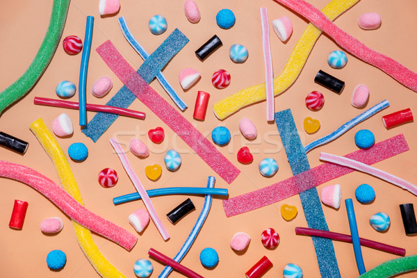 Top view of a mixed multicolored sweet candies and lollies Stock photo © deandrobot