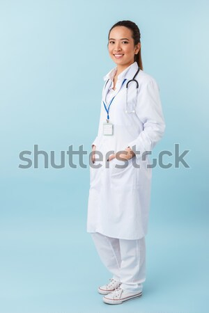 Smiling young nurse with stethoscope Stock photo © deandrobot