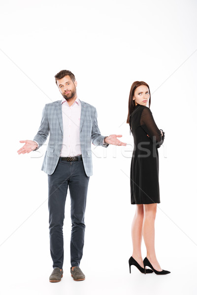 Offence young loving couple standing isolated Stock photo © deandrobot